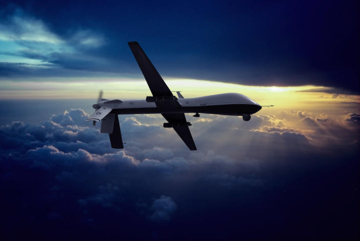 A military MQ-1 Predator unmanned drone with hellfire missiles flying at sunset. (Photo: Erik Simonsen via Getty)