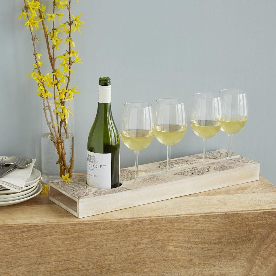 <p>This <span>Personalized Wine Serving Tray</span> ($85) is a party essential.</p>