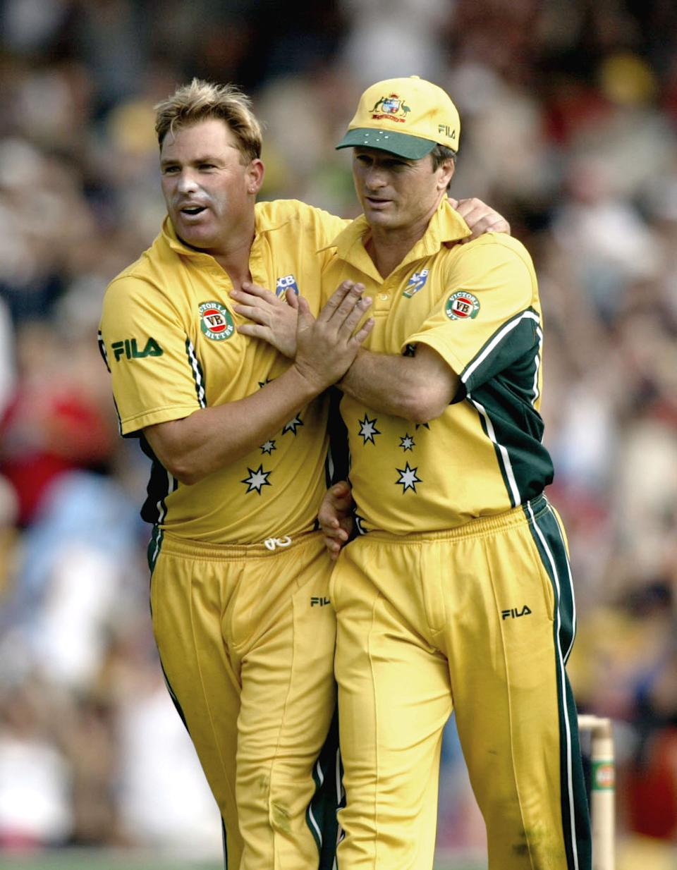 Steve Waugh celebrates and hugs Shane Warne to celebrate the wicket of Chris Carins of New Zealand.