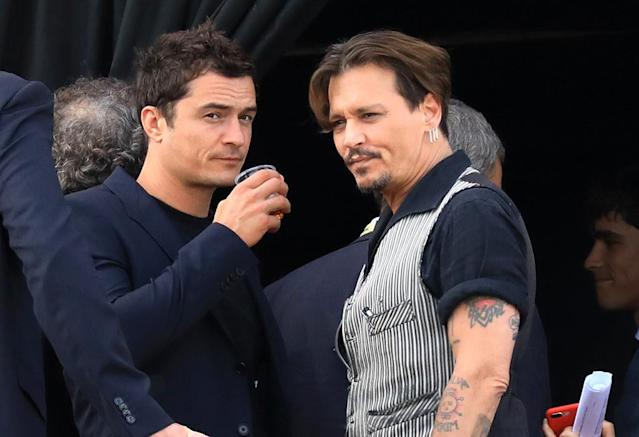 <p>Just two dudes having a drink … except Bloom and Depp happened to be at Disneyland Paris for the premiere of their movie, <i>Pirates of the Caribbean: Dead Men Tell No Tales</i>. (Photo: Best Image/BACKGRID) </p>