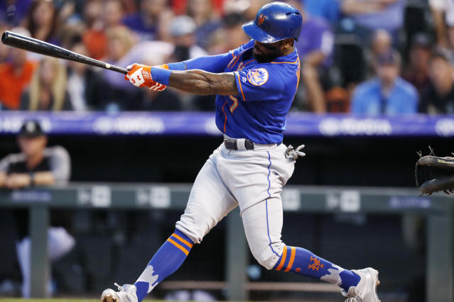 New York Mets' Jose Reyes swings for a double off Colorado Rockies starting pitcher Chad Bettis during the fifth inning of a baseball game Wednesday, June 20, 2018, in Denver. (AP Photo/David Zalubowski)