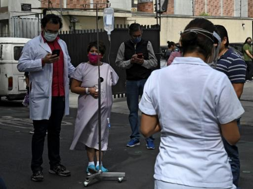 People gather outside a hospital in Mexico City on June 23 after a powerful quake rocked the south of the county