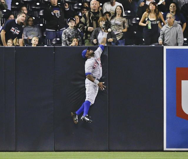 New York Mets left fielder Eric Young Jr. can't make the catch on a drive hit by San Diego Padres' Rene Rivera in the third inning of a baseball game, Thursday, Aug. 15, 2013, in San Diego. Rivera got a triple on the play. (AP Photo/Lenny Ignelzi)