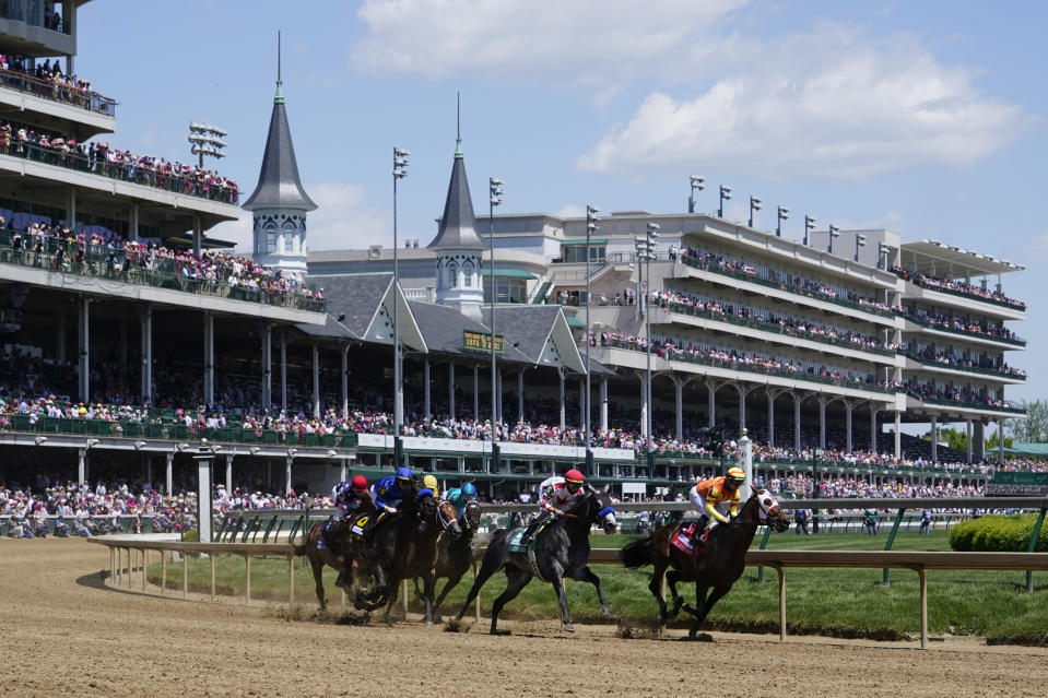 Umberto Rispoli rides Visitant to the lead in race six before 147th running of the Kentucky Oaks at Churchill Downs, Friday, April 30, 2021, in Louisville, Ky. (AP Photo/Michael Conroy)