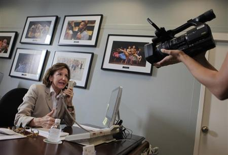 Sen. Kay Hagan (D-NC) answers phone calls from constituents in her office on Capitol Hill in Washington July 29, 2011. REUTERS/Yuri Gripas