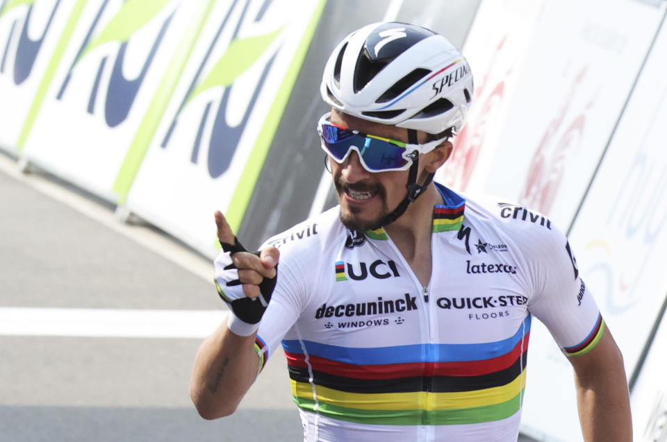 France's Julian Alaphilippe of the Deceuninck Quick-Step team crosses the finish line to win the Belgian cycling classic and UCI World Tour race Fleche Wallonne, in Huy, Belgium, Wednesday, April 21, 2021. (AP Photo/Olivier Matthys)
