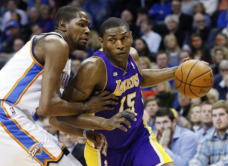 FILE - In this March 5, 2013 file photo, Los Angeles Lakers forward Metta World Peace (15) drives around Oklahoma City Thunder forward Kevin Durant (35) during an NBA basketball game in Oklahoma City. World Peace will have surgery Thursday, March 28 on a torn meniscus in his left knee and miss the next six weeks. The Lakers announced the timeline on Wednesday, March 27. (AP Photo/Sue Ogrocki, file)