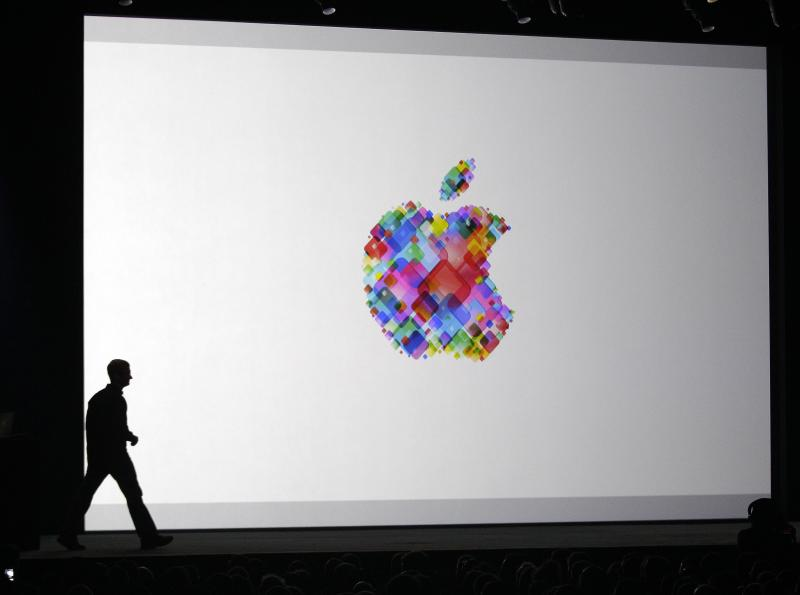 """Apple CEO Tim Cook enters the stage during the Apple Developers Conference in San Francisco,  Monday, June 11, 2012. Apple says it's introducing a laptop with a super-high resolution """"Retina"""" display, setting a new standard for screen sharpness. The new MacBook Pro will have a 15-inch screen and four times the resolution of previous models, Apple CEO Tim Cook told developers at a conference in San Francisco. (AP Photo/Marcio Jose Sanchez)"""