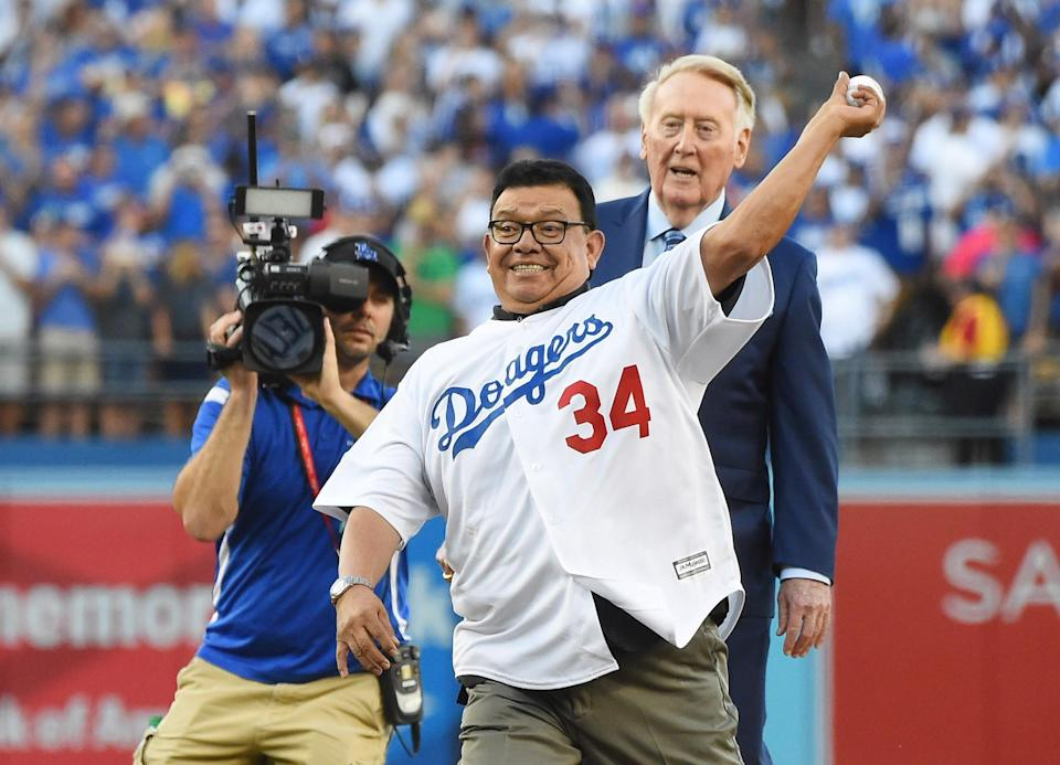 <p>Los Angeles Dodgers former pitcher Fernando Valenzuela throws out the ceremonial first pitch as broadcaster Vin Scully looks on before game two of the 2017 World Series against the Houston Astros at Dodger Stadium. Mandatory Credit: Jayne Kamin-Oncea-USA TODAY Sports </p>