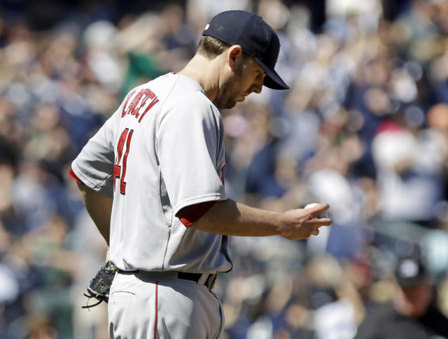 Boston Red Sox's John Lackey (41) reacts after New York Yankees' Brian McCann hit a two-run home run during the sixth inning of a baseball game Saturday, April 12, 2014, in New York. (AP Photo/Frank Franklin II)