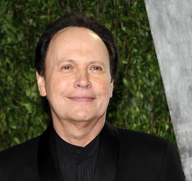 """FILE - In this Feb. 26, 2012 file photo, actor Billy Crystal arriving at the Vanity Fair Oscar party in West Hollywood, Calif. Crystal, who already donated $1 million to help Long Beach, N.Y., rebuild after Superstorm Sandy, has donated his time to appear in a TV ad that trumpets """"Long Beach is Open for Business."""" Crystal is a 1965 graduate of Long Beach High School. (AP Photo/Evan Agostini, File)"""