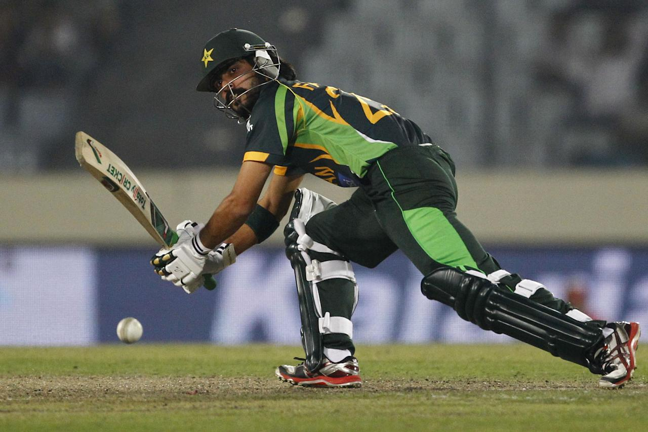 Pakistan's Fawad Alam plays a shot during their match against Bangladesh in the Asia Cup one-day international cricket tournament in Dhaka, Bangladesh, Tuesday, March 4, 2014. (AP Photo/A.M. Ahad)