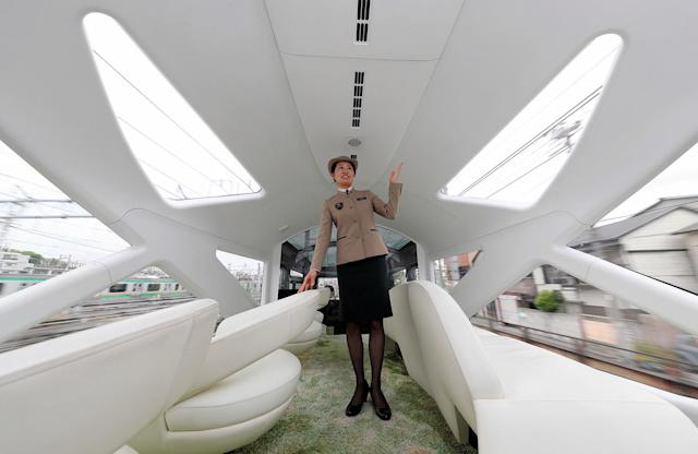 <p>A crew members shows one of the train's observation decks. (Photo: The Asahi Shimbun via Getty Images) </p>