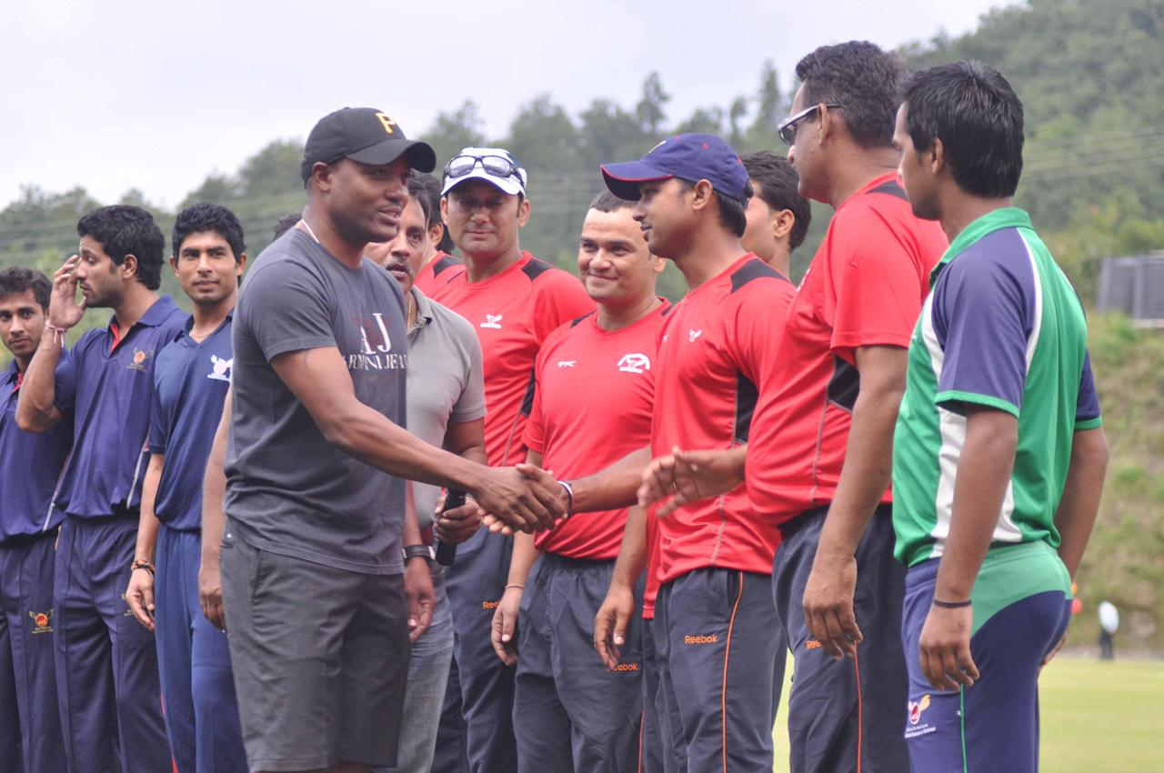 West Indies cricketer Brain Lara meets the students of Doon School in Dehradun on Oct. 3, 2013. A cricket match was organised between Doon School and Lara's team to raise funds for Kedarnath flood victims. (Photo: IANS)
