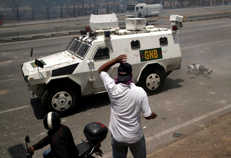 "An opposition demonstrator is struck by a Venezuelan National Guard vehicle on a street near the Generalisimo Francisco de Miranda Airbase ""La Carlota"" in Caracas, Venezuela April 30, 2019. (Photo: Ueslei Marcelino/Reuters)"