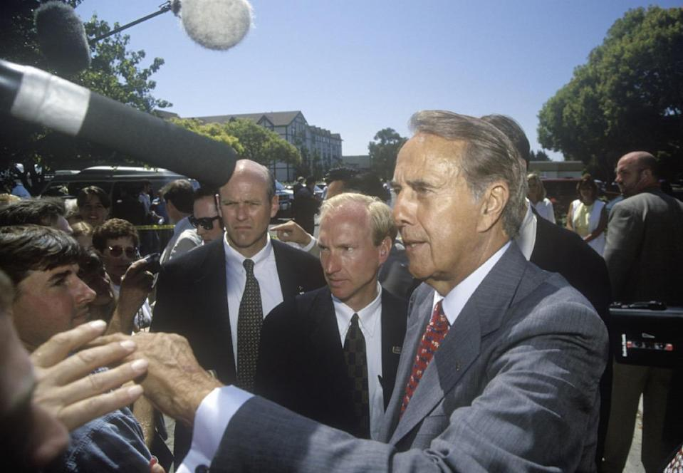 "The one-time presidential candidate grew up in the small town of <a href=""https://www.biography.com/political-figure/bob-dole"" rel=""nofollow noopener"" target=""_blank"" data-ylk=""slk:Russell, Kansas"" class=""link rapid-noclick-resp"">Russell, Kansas</a>, where he excelled in sports and worked as a paperboy before going on to attend the University of Kansas. Eventually, <strong>Bob Dole</strong> was elected into the Kansas House of Representatives and became senator of his home state. In 2014, Dole went on a <a href=""http://doleinstitute.org/get-involved/become-a-member/senator-doles-thank-tour/"" rel=""nofollow noopener"" target=""_blank"" data-ylk=""slk:&quot;thank you&quot; tour of Kansas"" class=""link rapid-noclick-resp"">""thank you"" tour of Kansas</a>, visiting each of the state's 105 counties. ""When I served in the Senate, I tried to serve everybody. So I hope to see everybody,"" he told <em><a href=""https://www.kansas.com/news/article1140433.html"" rel=""nofollow noopener"" target=""_blank"" data-ylk=""slk:The Wichita Eagle"" class=""link rapid-noclick-resp"">The Wichita Eagle</a> </em>at the time. ""I'm not asking for money or asking for votes. I just want to shake hands, share a few stories. Answer any questions. I want to thank all the people who supported me for 30 years. And maybe eat an oatmeal or a chocolate chip cookie at every stop."""