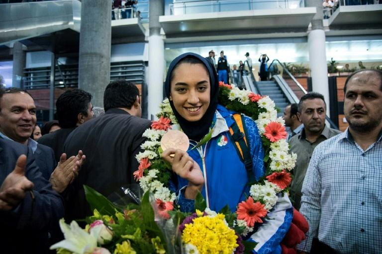 Kimia Alizadeh, who became the first Iranian woman ever to win an Olympic medal, pictured in 2016 with her medal at Tehran's Imam Khomeini International Airport