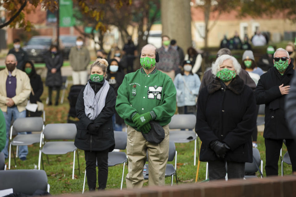 Marshall University hosts its 50th Annual Memorial Fountain Service on Saturday, Nov. 14, 2020, at the Memorial Student Center in Huntington, W.Va. Marshall commemorated the 50th anniversary of the worst disaster in U.S. sports history, when 75 people, including most of the football team, were killed in a Nov. 14, 1970, plane crash.(Sholten Singer/The Herald-Dispatch via AP)