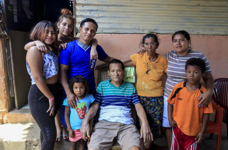 Franklin Perez, 29, wearing a solid blue jersey, poses with his family in their home, after he was released to house arrest, in Managua, Nicaragua, Friday, April 5, 2019. Perez is among the 50 people released Friday who had been jailed for protesting against President Daniel Ortega's government. However charges were not dropped against the demonstrators. Instead they were for the most part transferred to a form of house arrest, short of the unrestricted freedom that the opposition has demanded. (AP Photo/Alfredo Zuniga)