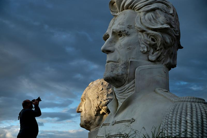 George Washington and Andrew Jackson can be seen as a man takes a photo of decaying busts of former US Presidents during a night photography workshop organized by John Plashal August 25, 2019, in Williamsburg, Virginia.(Photo: Brendan Smialowski/AFP/Getty Images)