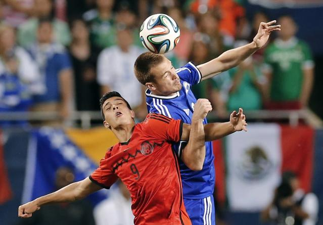 Mexico's Raul Jimenez battles for the ball against Bosnia and Herzegovina's Toni Sunjic during their international friendly soccer match in Chicago