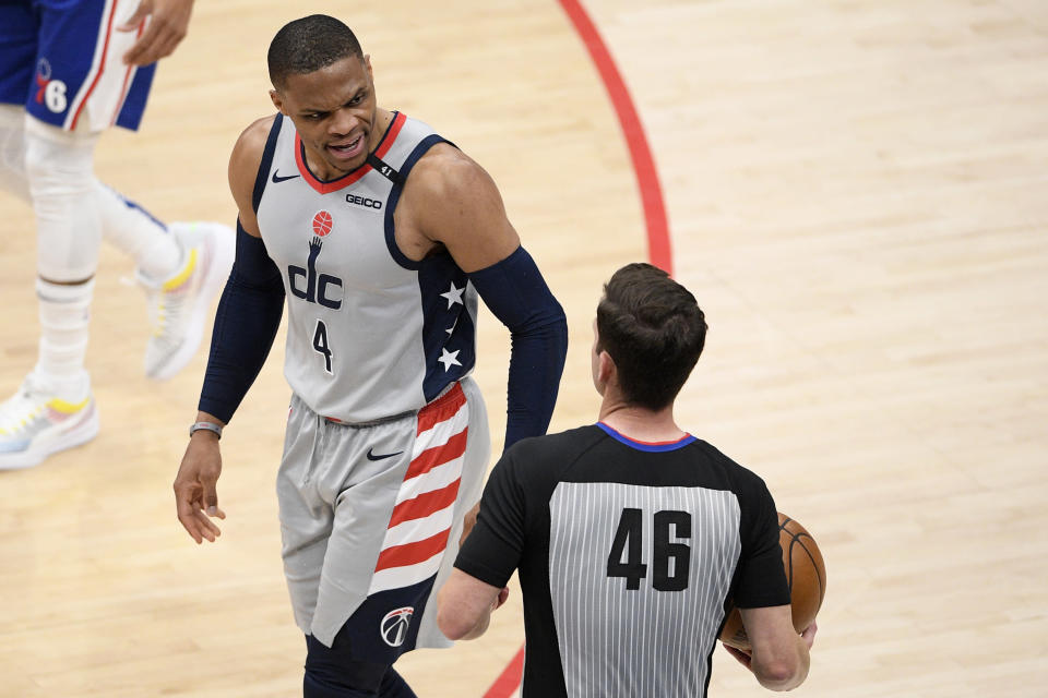 Washington Wizards guard Russell Westbrook (4) reacts to referee Ben Taylor (46) after being called for a foul during the second half of Game 3 in a first-round NBA basketball playoff series against the Philadelphia 76ers, Saturday, May 29, 2021, in Washington. (AP Photo/Nick Wass)