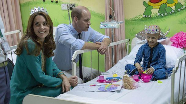 PHOTO: The Duke and Duchess of Cambridge with seven-year-old cancer patient Wafia Remain, during a visit to Shaukat Khanum Memorial Cancer Hospital and Research Centre in Lahore, Pakistan, Oct. 17, 2019, on the fourth day of the royal visit to Pakistan. (Arthur Edwards/PA Wire via ZUMA Press)