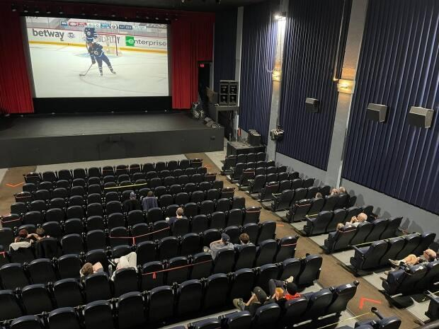 Patrons of the Rio Sports Bar watch hockey on the big screen.