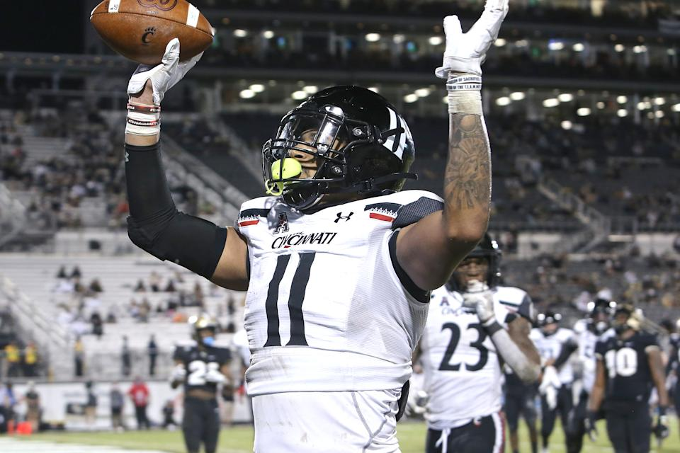 Leonard Taylor of the Cincinnati Bearcats celebrates as he scores a touchdown against Central Florida on Nov.21, 2020. (Alex Menendez/Getty Images)