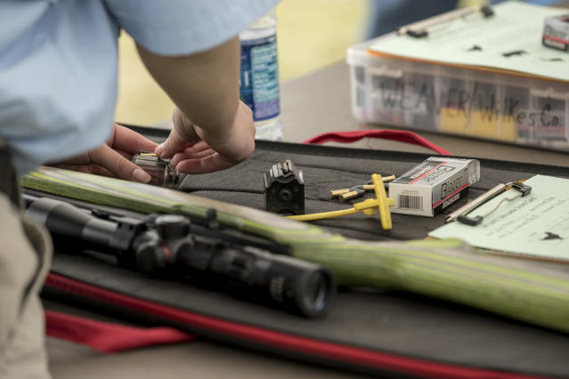 Reloading at the .22 Rimfire Silhouette Exhibition Match. (Photo: Ben Rollins for Yahoo News)