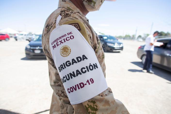 """A Mexican soldier wears an armband reading """"COVID-19 Vaccination Brigade"""" as part of the vaccination efforts in Juárez on Monday, April 12, 2021."""
