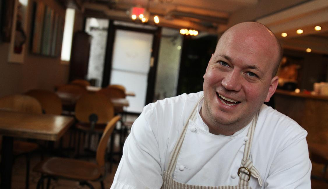 In this photo taken May 4, 2016 chef Justin Carlisle sits in the dining room of his restaurant, Ardent, in Milwaukee. This year, Carlisle made it to the final round of the James Beard Awards, considered the Oscars of the food world. He was also a semi-finalist in the best new restaurant category in 2014 and made it to the finals in 2015. (AP Photo/Carrie Antlfinger)