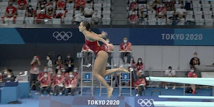 Screenshot shows Pamela Ware vertical in the air on a dive attempt at the Tokyo Olympics.