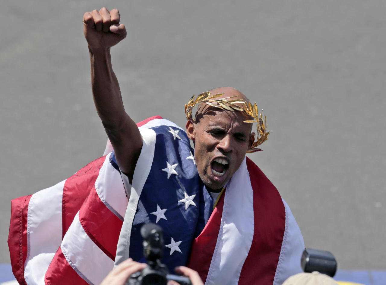 Meb Keflezighi, of San Diego, Calif., celebrates his victory in the 118th Boston Marathon Monday, April 21, 2014 in Boston. (AP Photo/Charles Krupa)