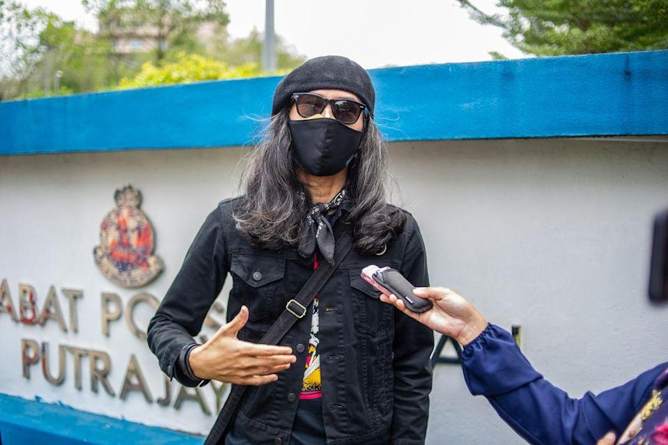File picture shows activist Fahmi Reza speaking to a reporter outside the Putrajaya district police headquarters March 10, 2021. — Picture by Shafwan Zaidon