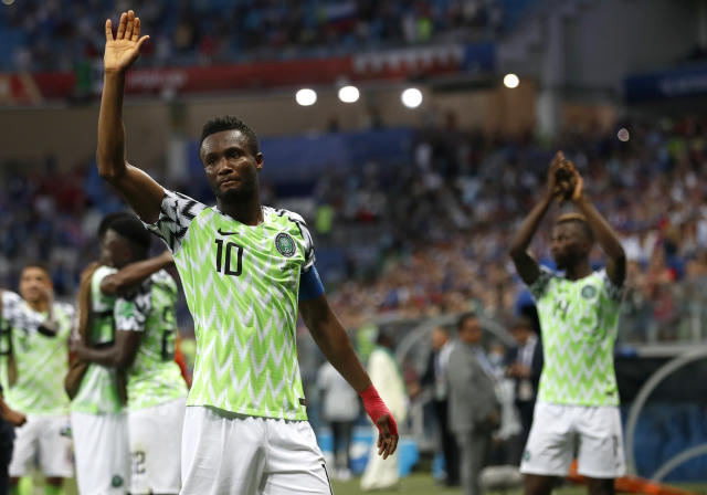 Nigeria's John Obi Mikel waves to his team's supporters after their 2-0 win in group D over Iceland at the 2018 soccer World Cup in the Volgograd Arena in Volgograd, Russia, Friday, June 22, 2018. (AP Photo/Darko Vojinovic)