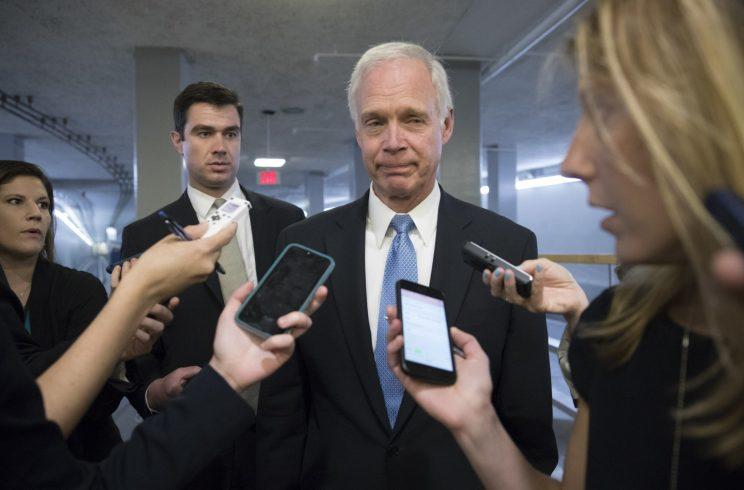 Sen. Ron Johnson, R-Wisc., center, who has expressed opposition to his own party's health care bill, walks to a policy meeting as the Senate Republican legislation teeters on the brink of collapse, at the Capitol in Washington, Tuesday, June 27, 2017. (Photo:J. Scott Applewhite/AP)