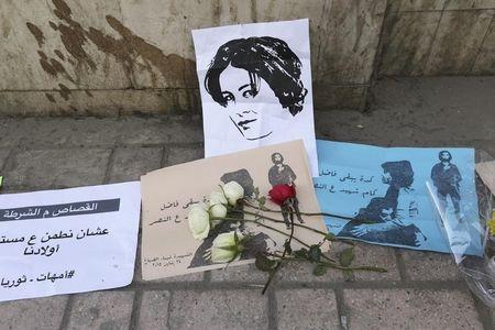 Flowers are seen left at the spot where activist Shaimaa Sabbagh died during a protest on Saturday, in central Cairo