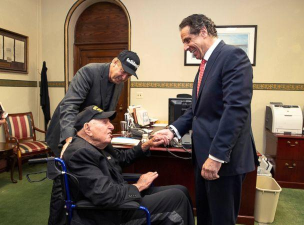 PHOTO: Governor Andrew M. Cuomo, right, shakes hands with World War II veteran Sidney Walton at the Capitol in Albany, N.Y., May 18, 2018. (Mike Groll/Office of Governor Andrew M. Cuomo via AP)