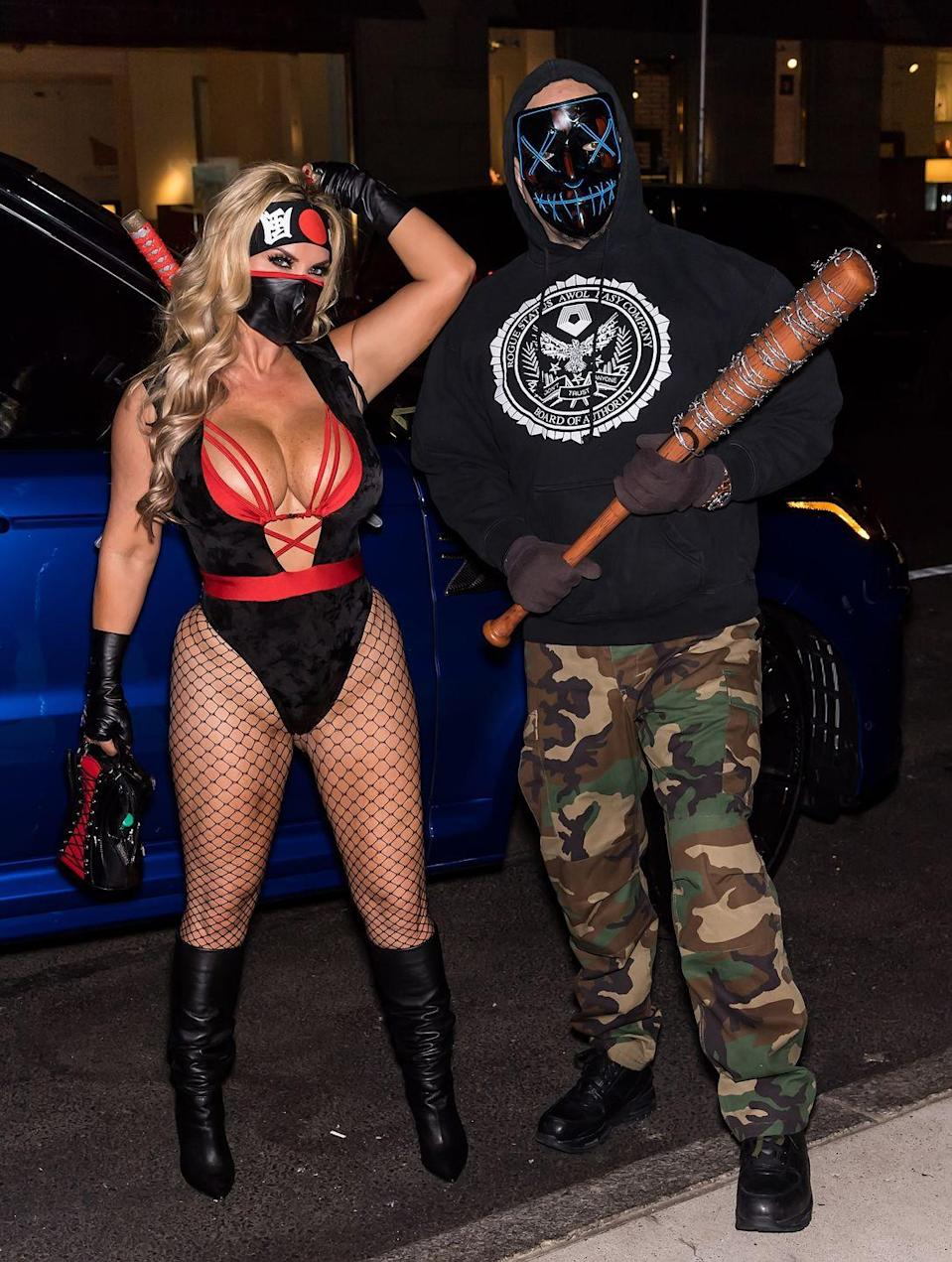<p>To be fair, this doesn't qualify as a *true* couples costume, since Coco and her husband Ice-T are dressed as separate characters (her, a ninja; him, a person in <em>The Purge</em>). But since they coordinated their bats and overall style, this one still counts.</p>