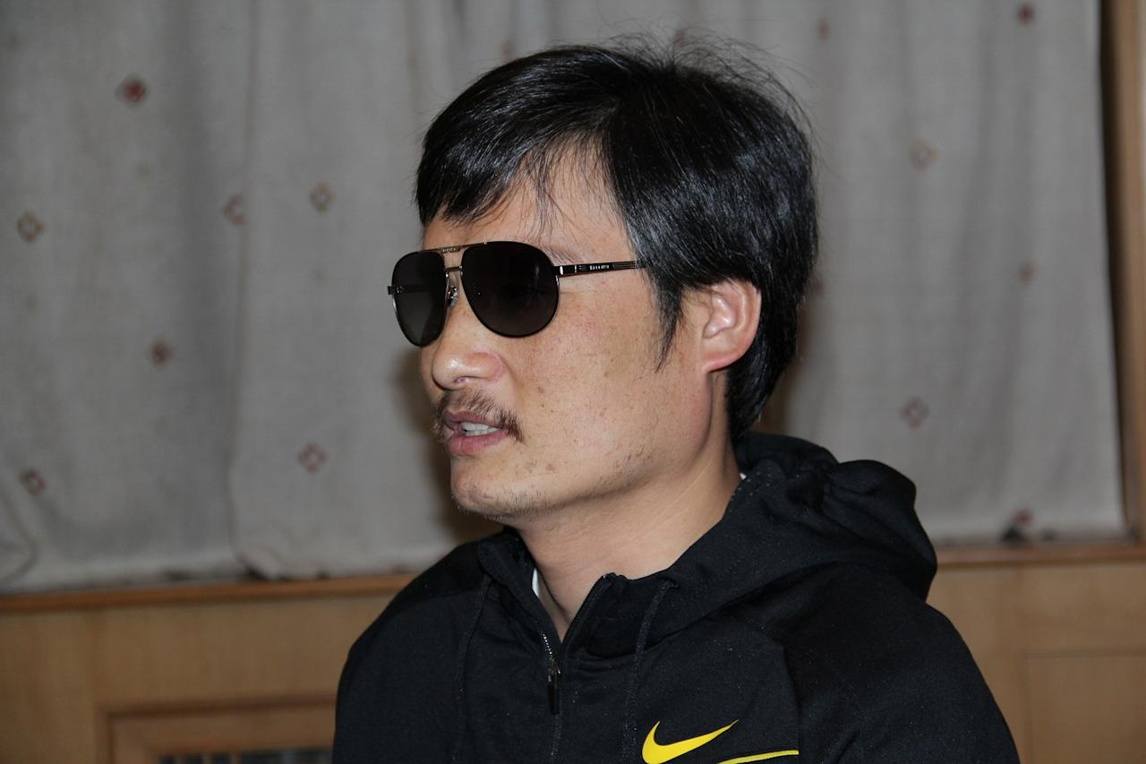 In this photo taken in late April, 2012, and released by Zeng Jinyan, blind Chinese legal activist Chen Guangcheng is seen at an undisclosed location in Beijing during a meeting with human rights activists Hu Jia and Zeng Jinyan. Chen, an inspirational figure in China's rights movement, slipped away from his well-guarded rural village on April 22, 2012, and made it to a secret location in Beijing on Friday, April 27. Activists say he is under the protection of U.S. diplomats in Beijing. (AP Photo/Zeng Jinyan)