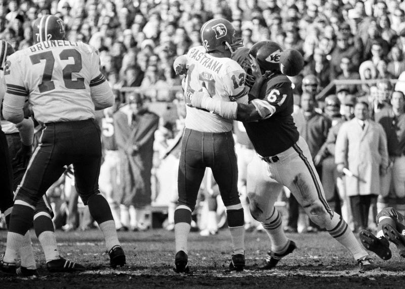 FILe - In this Dec. 7, 1970 file photo, Kansas City's Curley Culp (61) hits Denver quarterback Al Pastrana causing him to fumble during a football game in Kansas City, Mo. Culp will be inducted into the Pro Football Hall of Fame on Saturday, Aug. 3, 2013, in Canton, Ohio. (AP Photo/File)