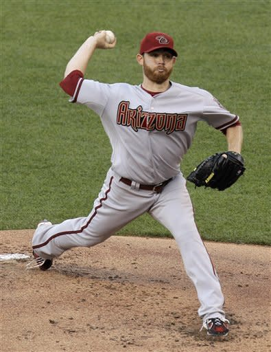 Arizona Diamondbacks starting pitcher Ian Kennedy throws during the first inning of a baseball game against the Kansas City Royals on Saturday, May 19, 2012, in Kansas City, Mo. (AP Photo/Charlie Riedel)
