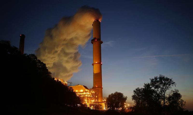 Emissions rise from the Northern Indiana Public Service Co. Bailly generating station. By promoting coal power, President Trump could try to alter the economics of pursuing low-carbon.