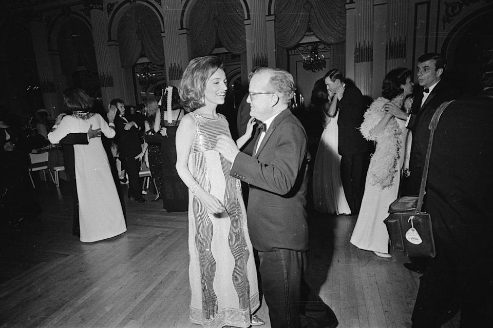 <p>Jackie Kennedy's little sister, Lee Radziwill, who was married to Prince Stanislaw Radziwill at the time, dances with Truman Capote at his Black and White Ball at the Plaza Hotel in 1966. </p>