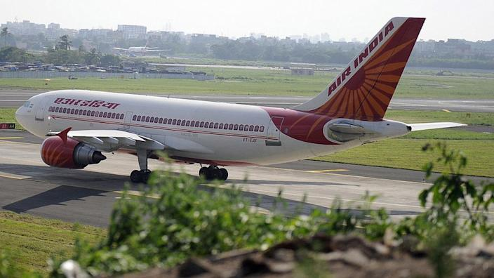 An Indian Airlines plane taxes towards takeoff at Mumbai airport on September 27, 2009.