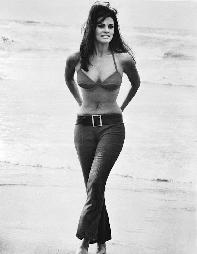 """<b>Raquel Welch in """"The Biggest Bundle of Them All,"""" 1968:</b> """"This is the world's sexiest robbery!"""" declared the posters for crime caper """"The Biggest Bundle of Them All,"""" surely referring to the scene-stealing curves of star Raquel Welch. When she wasn't costumed in the tiniest of bikinis, Welch spent her screen time poured into equally seductive hip-huggers.   <b><a href=""""http://www.instyle.com/instyle/package/general/photos/0,,20294121_20293526_20649515,00.html?xid=omg-10hairstyles?yahoo=yes"""" target=""""new"""">10 Hairstyles That Are Always in Style</a></b> Courtesy Everett Collection - 1968"""