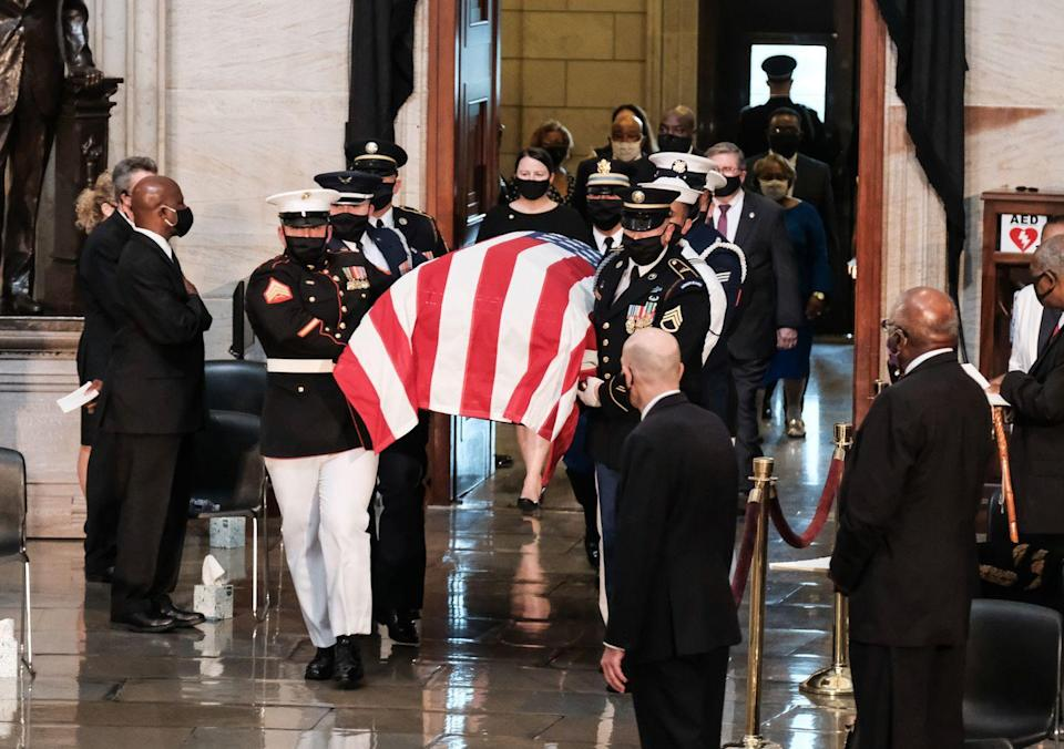 <p>Members of the military place the casket of the late Rep. John Lewis (D-GA) while arriving inside of the Rotunda prior to the start of the ceremony preceding the lying in state of US Representative from Georgia John Lewis in the Rotunda of the US Capitol in Washington, DC, on July 27, 2020.</p>