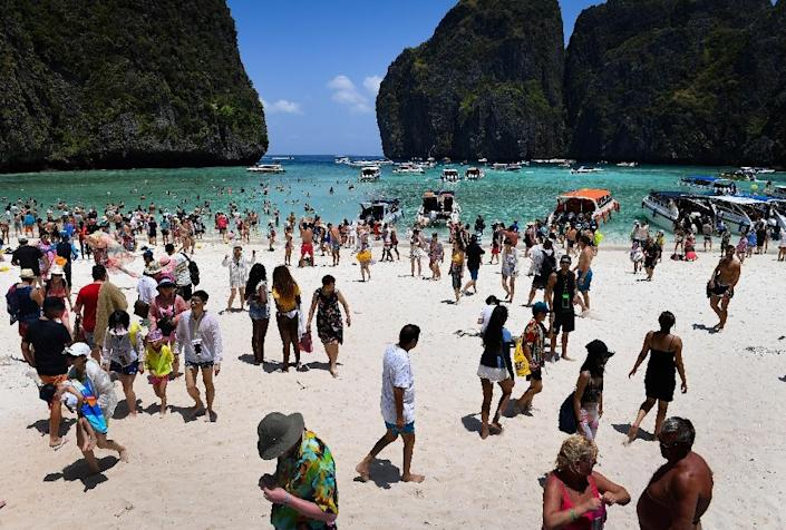 The 2000 movie 'The Beach' prompted hordes of tourists to visit, damaging the coral ecosystem and eroding the once pristine white sand beach (AFP Photo/Lillian SUWANRUMPHA)