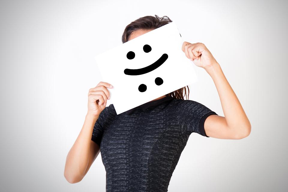 Young woman facing bipolar disorder - happy and sad two-faced expression